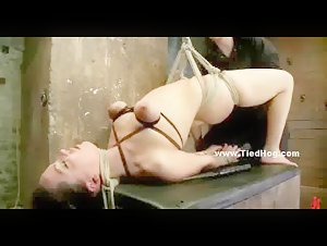 Babe suspended in the air with her boobs strangled really tight and tortured in bondage rough video